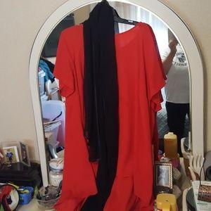 Orange dress with black scarf